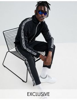 Pull&Bear Exclusive Tracksuit Bottoms In Black With Logo Side Stripe by Pull&Bear
