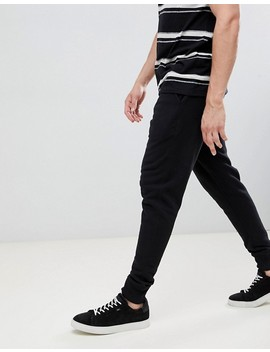 All Saints Cuffed Jogger In Black With Ramskull Logo by All Saints