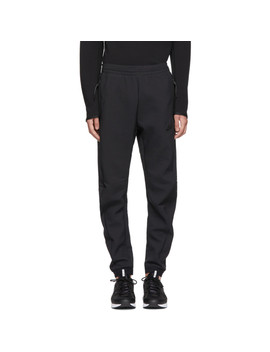 Black Tech Pack Woven Track Pants by Nike
