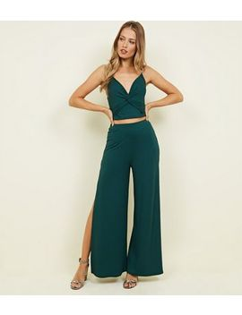 Dark Green Ribbed Flared Split Side Trousers by New Look