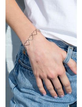 Silver Hearts Bracelet by Brandy Melville