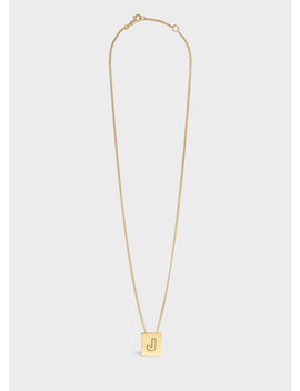 Alphabet J Necklace In Brass With Gold Finish by Celine