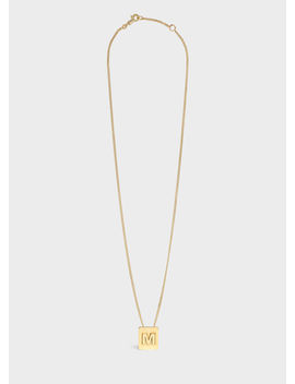 Alphabet M Necklace In Brass With Gold Finish by Celine