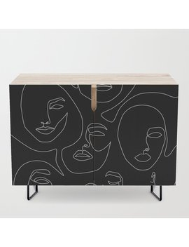 Faces In Dark Credenza by