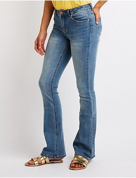 Mid Rise Flared Jeans by Charlotte Russe