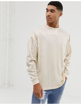 Asos Design Oversized Longline Long Sleeve T Shirt With Contrast Woven Fabric Yoke And Sleeve With Zip Pocket In Beige by Asos Design