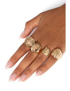 Living On A Prayer Ring Set   Gold by Fashion Nova