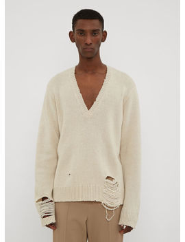 Distressed V Neck Sweater In Cream by Maison Margiela