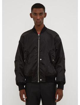 Reverse Snap Stud Bomber Jacket In Black by Maison Margiela
