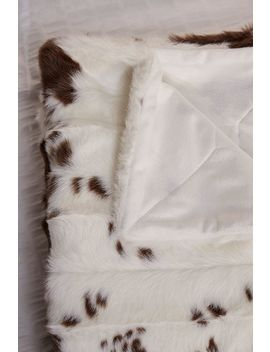 Cow Print Faux Fur Throw Blanket by Urban Outfitters
