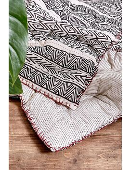 Linear Geo Print Quilted Throw Blanket by Urban Outfitters