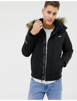 Hollister All Weather Fleece Lined Hooded Bomber Faux Fur Trim In Black by Hollister