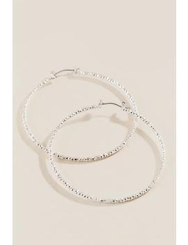 Delicia Diamond Cut Hoop Earrings by Francesca's
