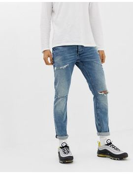 River Island Ripped Skinny Jeans In Mid Wash Blue by River Island