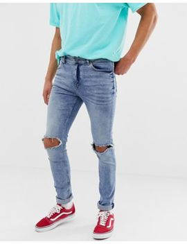Cheap Monday Skinny Jeans With Knee Rips In Blue by Cheap Monday