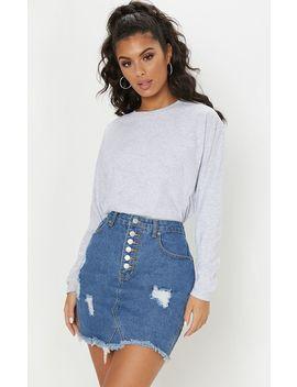 Mid Wash Button Through Distressed Denim Skirt by Prettylittlething