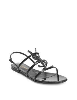 Women's Black Cassandra Leather Flat Sandals by Saint Laurent
