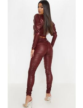 Maroon Coated Ruched Side Legging by Prettylittlething