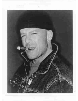 Photo Of Bruce Willis Smoking A Cigar by Photographic Archives