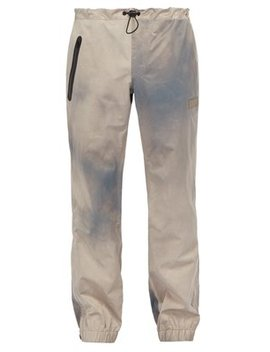 Wave Dye Waterproof Track Pants by P.A.M.