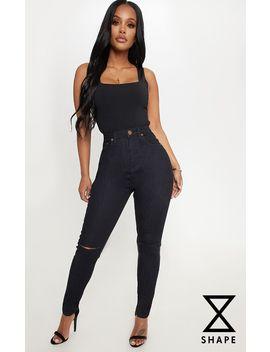 Shape Black Knee Rip Skinny Jean  by Prettylittlething