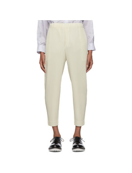 Off White Pleated Tapered Trousers by Homme PlissÉ Issey Miyake