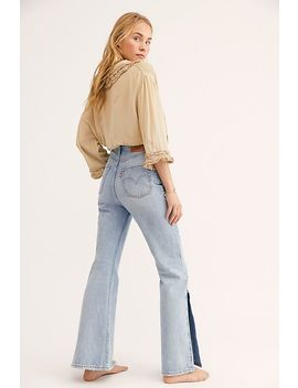 Levi's Ribcage Split Flare Jeans by Free People
