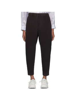 Grey Pleated Tapered Trousers by Homme PlissÉ Issey Miyake