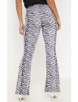 Petite Zebra Print Flare Trousers by Prettylittlething