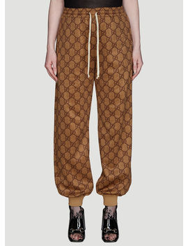 Gg Print Jogging Track Pants In Brown by Gucci