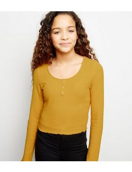 girls-mustard-ribbed-popper-front-long-sleeve-top by new-look