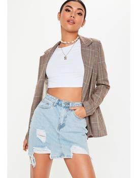 Blue Light Wash Distressed Hem Denim Skirt by Missguided