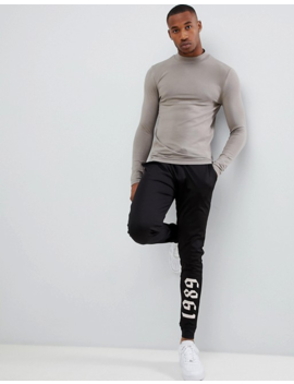 Asos Design Muscle Fit Long Sleeve Turtleneck T Shirt With Stretch In Beige by Asos Design