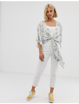Qed London Angel Sleeve Tie Front Top In Blue Floral Print by Top