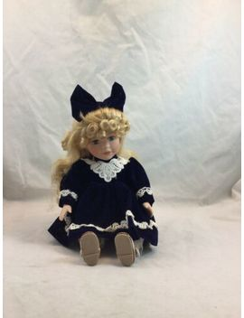 "Porcelain Doll   14""   Blonde Hair, Blue Eyes, Navy Blue Velvet Dress   Sitting by Ebay Seller"
