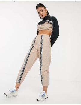 Adidas Originals   Ryv   Trainingbroek Met Streep In Lichtroze by Adidas