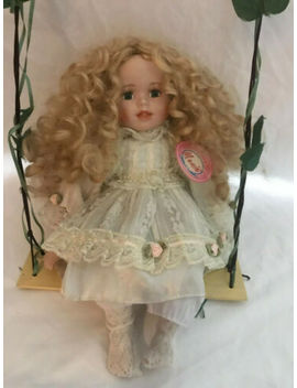 "Fine Collection Dolls "" Menie"" Porcelian Doll On A Swing, Blond Curly Hair by Fine Collection"