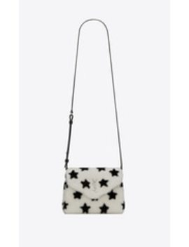 loulou-toy-bag-in-shearling-with-a-star-print by saint-laurent