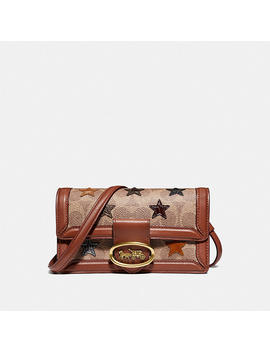 Riley Convertible Belt Bag In Signature Canvas With Star Applique And Snakeskin Detail by Coach