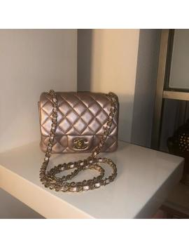 metallic-square-mini-iridescent-pink-lambskin-leather-cross-body-bag by chanel