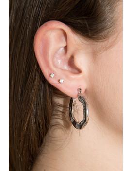 Silver Textured Hoop Earrings by Brandy Melville