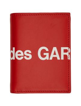 red-huge-logo-bifold-card-holder by comme-des-garÇons-wallets