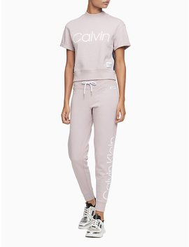 Performance Logo Mock Neck Ombre Stripe Cropped T Shirt by Calvin Klein