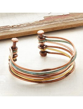 Mixed Metals Hinged Cuff by Uncommon Goods