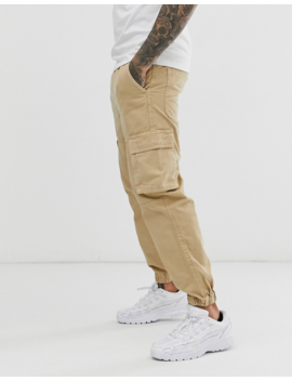 Bershka Cargo Trousers With Pocket Detail In Beige by Bershka