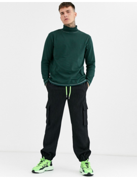 Asos Design Relaxed Long Sleeve T Shirt With Roll Neck And Contrast Stitching In Green by Asos Design