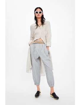 PrĄŻkowane Spodnie Typu Slouchy Z Paskiem Wszystko Od 70% WyprzedaŻ Kobieta by Zara