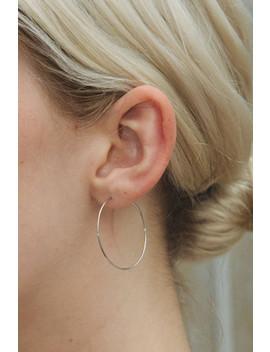 Silver Thin Hoop Earrings by Brandy Melville