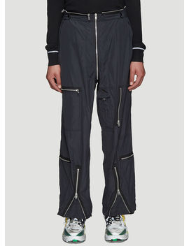 Zip Combat Pants In Black by Maison Margiela