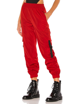 Jorja Windbreaker Pant In Red by Superdown